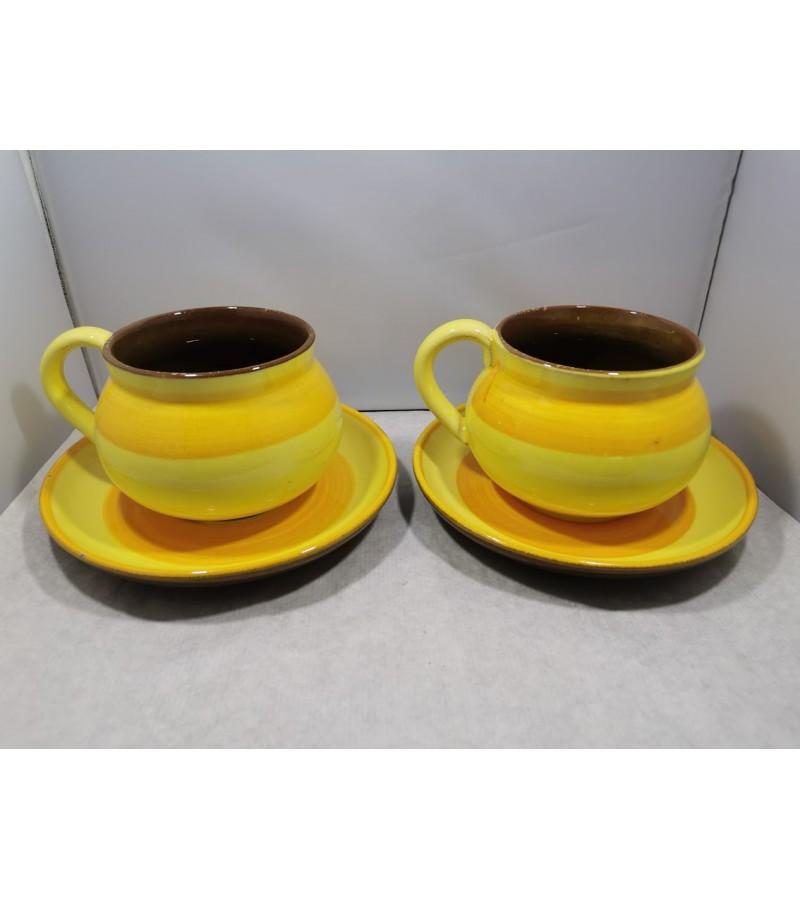 Indai, puodeliai keraminiai, moliniai, glazūruoti, vintažiniai. 2 vnt. Talpa po 0,5 ltr. Kaina 10 už abu.
