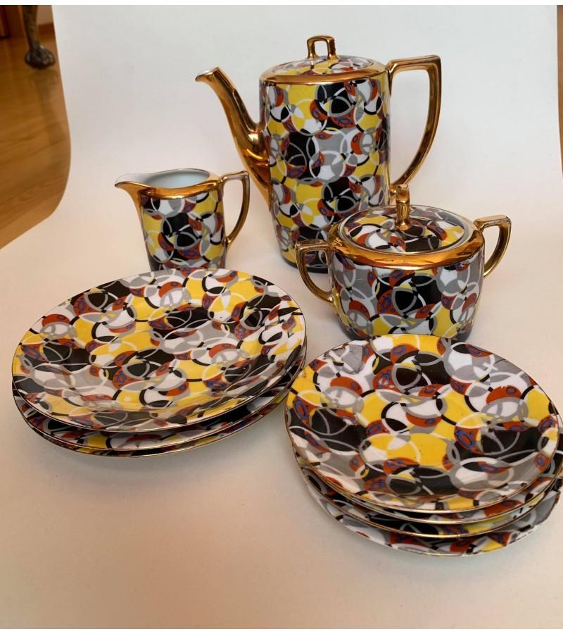 Indai porcelianiniai, Art Deco stiliaus. Arbatinukas - kavinukas, grietinėlės indelis, cukrinė kaina po 13, lėkštutės po 3.