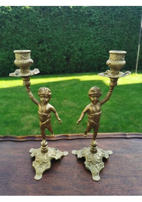 Žvakidės bronzinės, antikvarinio stiliaus - berniukai. 2 vnt. Aukštis 25 cm. Svoris po 500 g. Kaina po 38