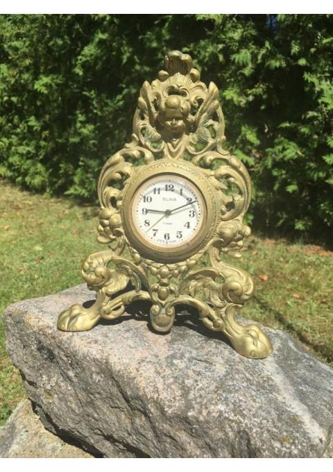 Laikrodis bronziniame remelyje. Kaina 27