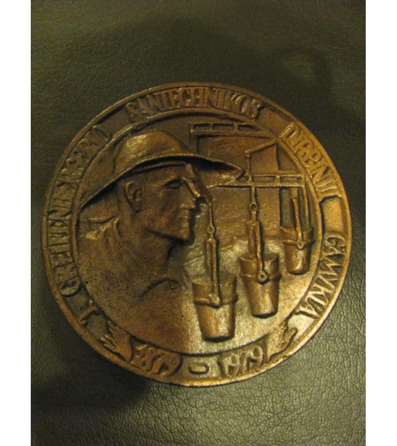 Stalo medalis. Kaina 7 Eur.