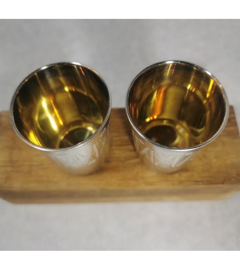 Taurelės, stikliukai sidabrinės ornamentuotos, auksuotu vidum. 2 vnt. Praba 875. Svoris abiejų 63 gr. Kaina 142